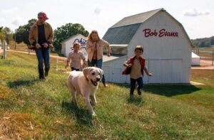 Family and dog running in Bob Evans Farm open thanksgiving